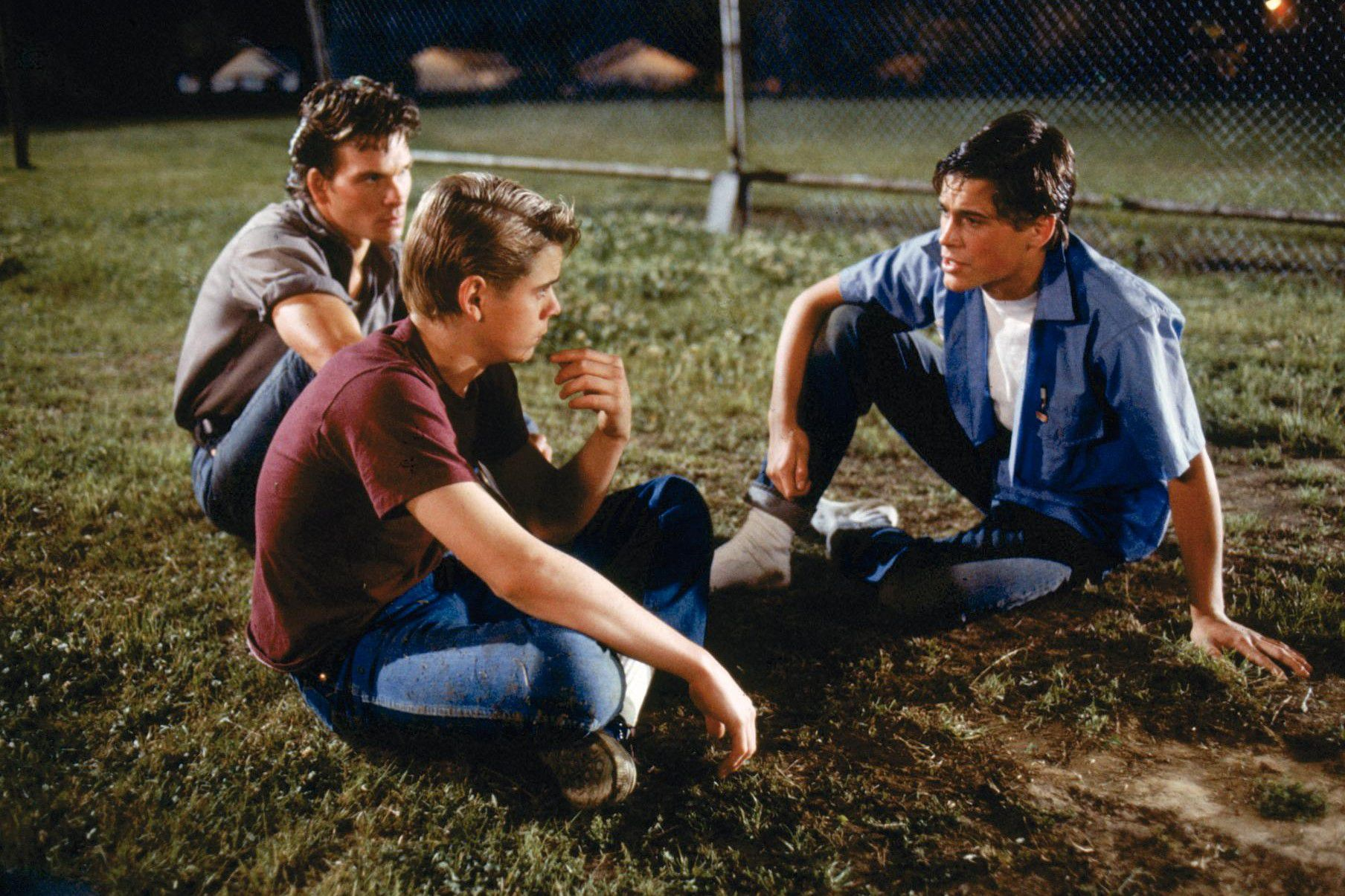 "outsiders gang and social boys Confrontation—rival teen gangs square off in the outsiders, which  the  socs (short for ""social""), a collective of have-it-made rich kids."