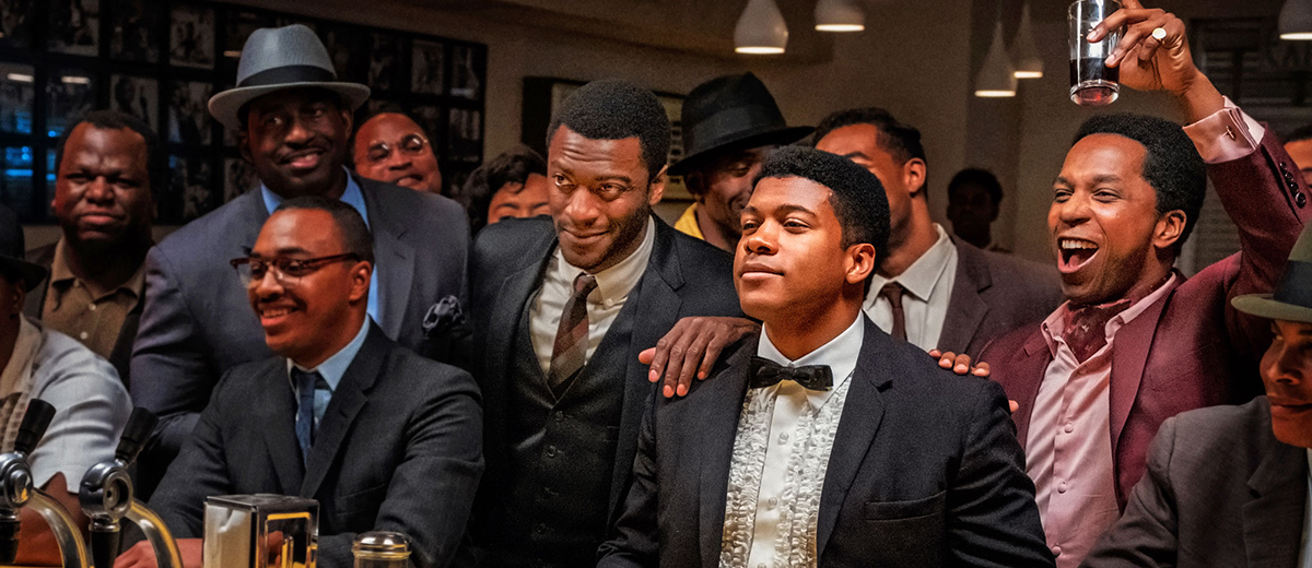 Following his 1964 world heavyweight boxing title win, Cassius Clay's (Eli Goree) gathers his mentor, Malcolm X (Kingsley Ben-Adir), NFL star Jim Brown (Aldis Hodge), and famous singer Sam Cooke (Leslie Odom Jr) stand at a bar waiting for drinks.