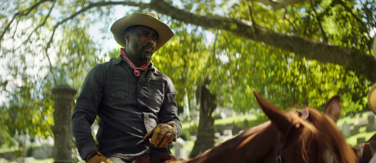 Harp, played by Idris Elba, sits on horseback in the film CONCRETE COWBOY